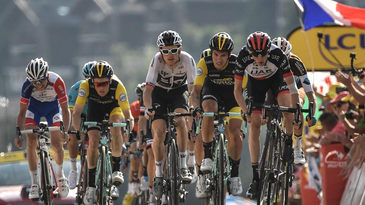 Great Britain's Geraint Thomas (C) crosses the finish line of the tenth stage of the 105th edition of the Tour de France cycling race between Annecy and Le Grand-Bornand, French Alps, on July 17, 2018.