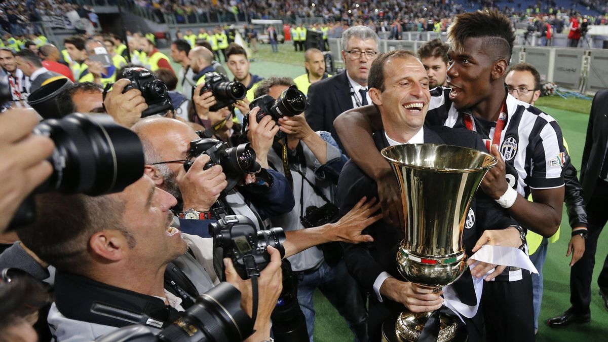 Juventus coach Massimiliano Allegri and Paul Pogba celebrate with the trophy after winning the Italian Cup Final