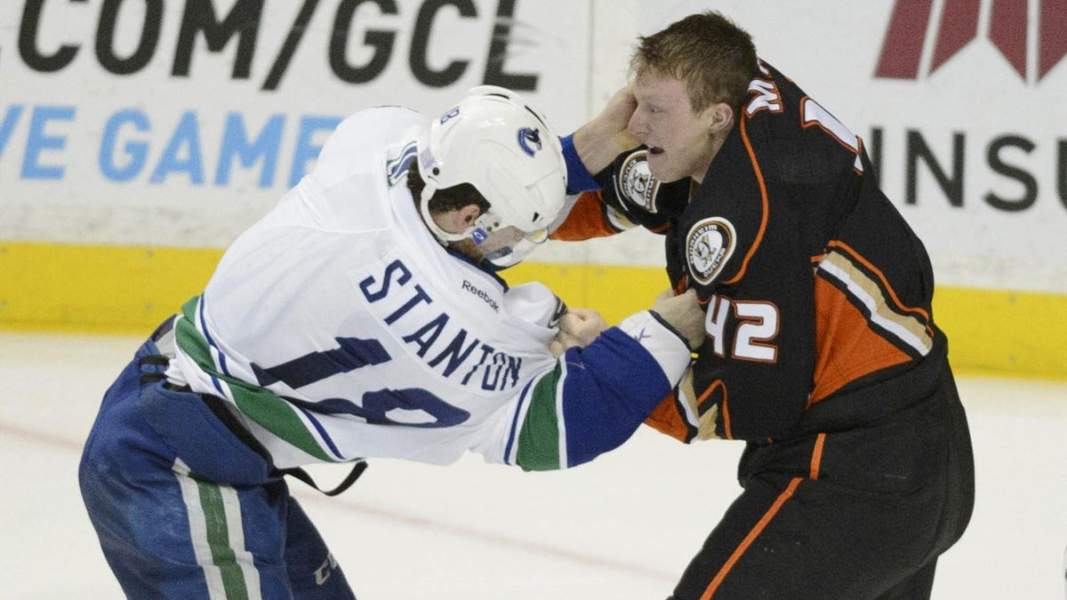 Vancouver Canucks defenseman Ryan Stanton (L) and Anaheim Ducks defenseman Josh Manson (R) fight