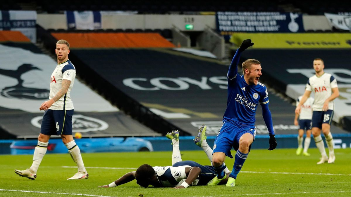Leicester City's English striker Jamie Vardy (R) celebrates after his header is deflected into his own net by Tottenham Hotspur's Belgian defender Toby Alderweireld (L) for their second goal during the English Premier League football match between Tottenh