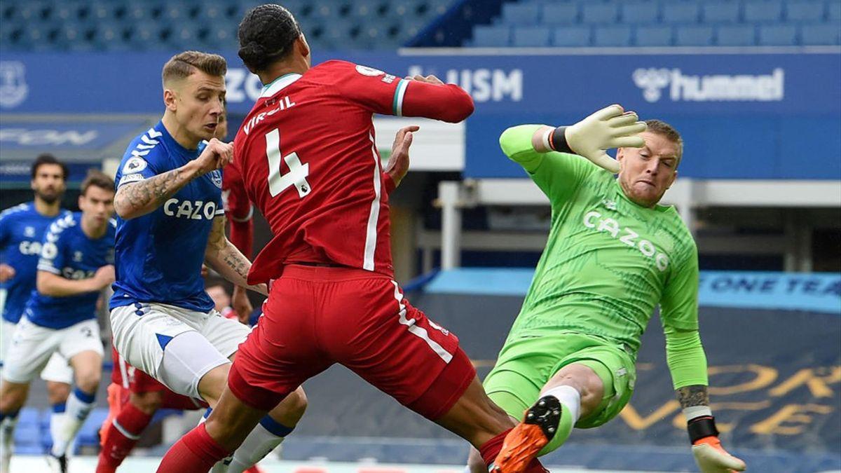 Jordan Pickford of Everton takes out Virgil van Dijk of Liverpool
