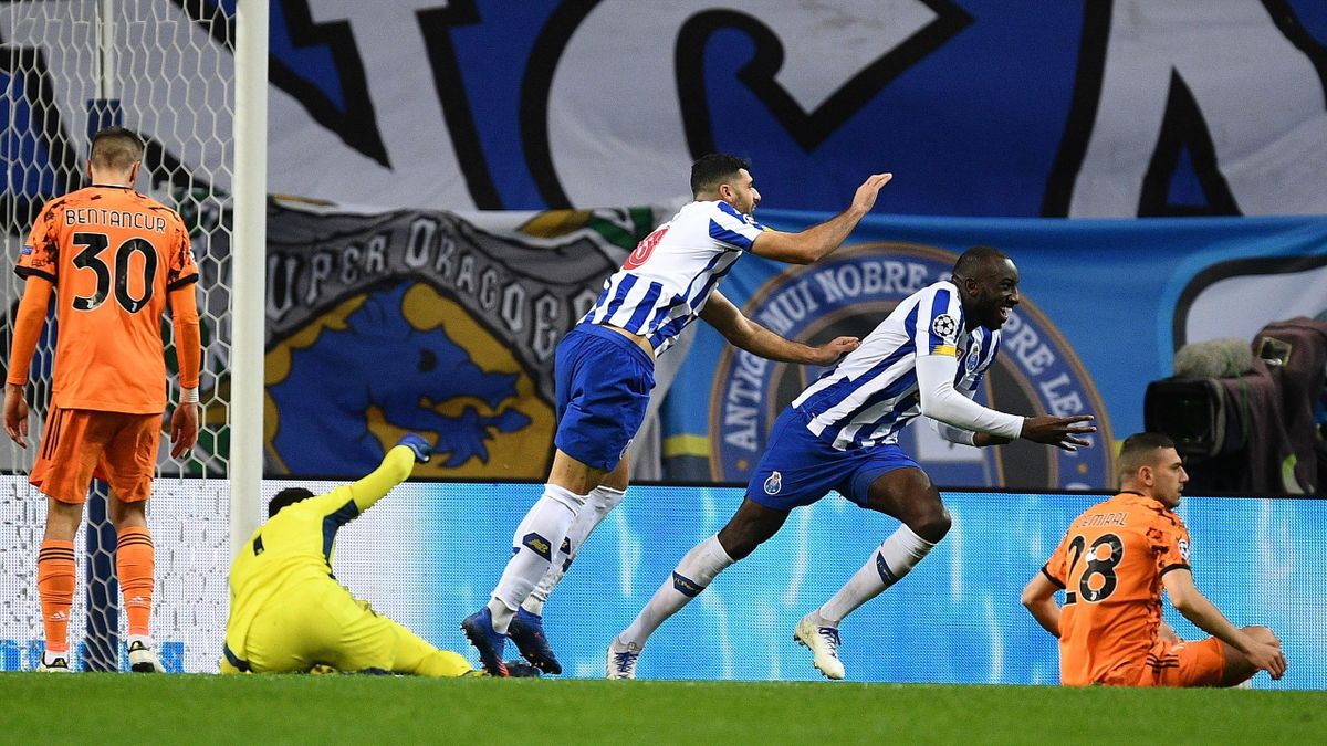 Moussa Marega of FC Porto celebrates with Mehdi Taremi after scoring his team's second goal during the UEFA Champions League Round of 16 match between FC Porto and Juventus at Estadio do Dragao on February 17, 2021 in Porto,