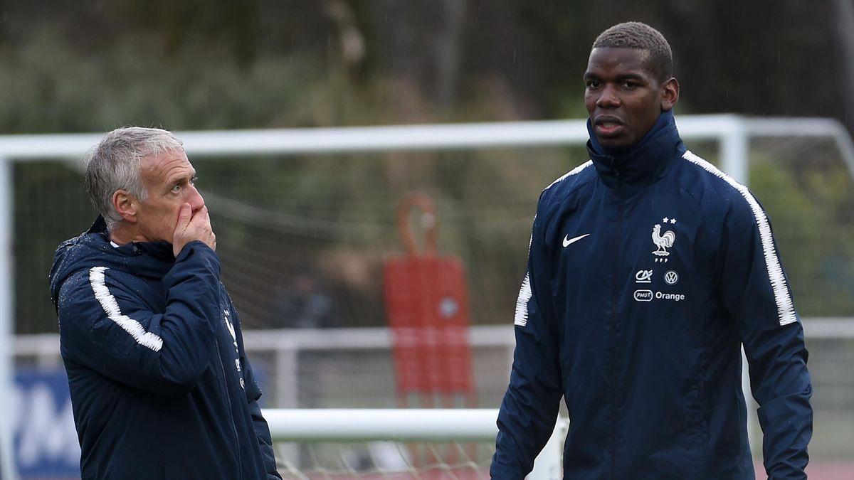 France head coach Didier Deschamps (L) and the midfielder Paul Pogba (R)