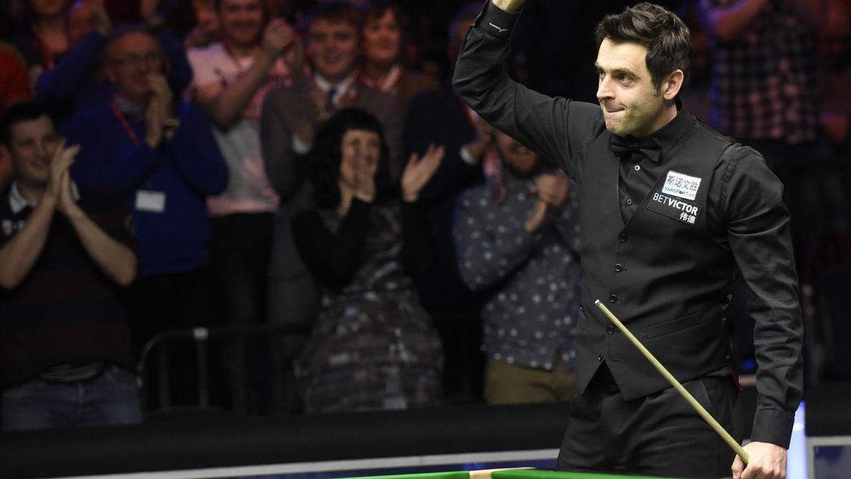 Ronnie O'Sullivan celebrates winning the Welsh Open title.