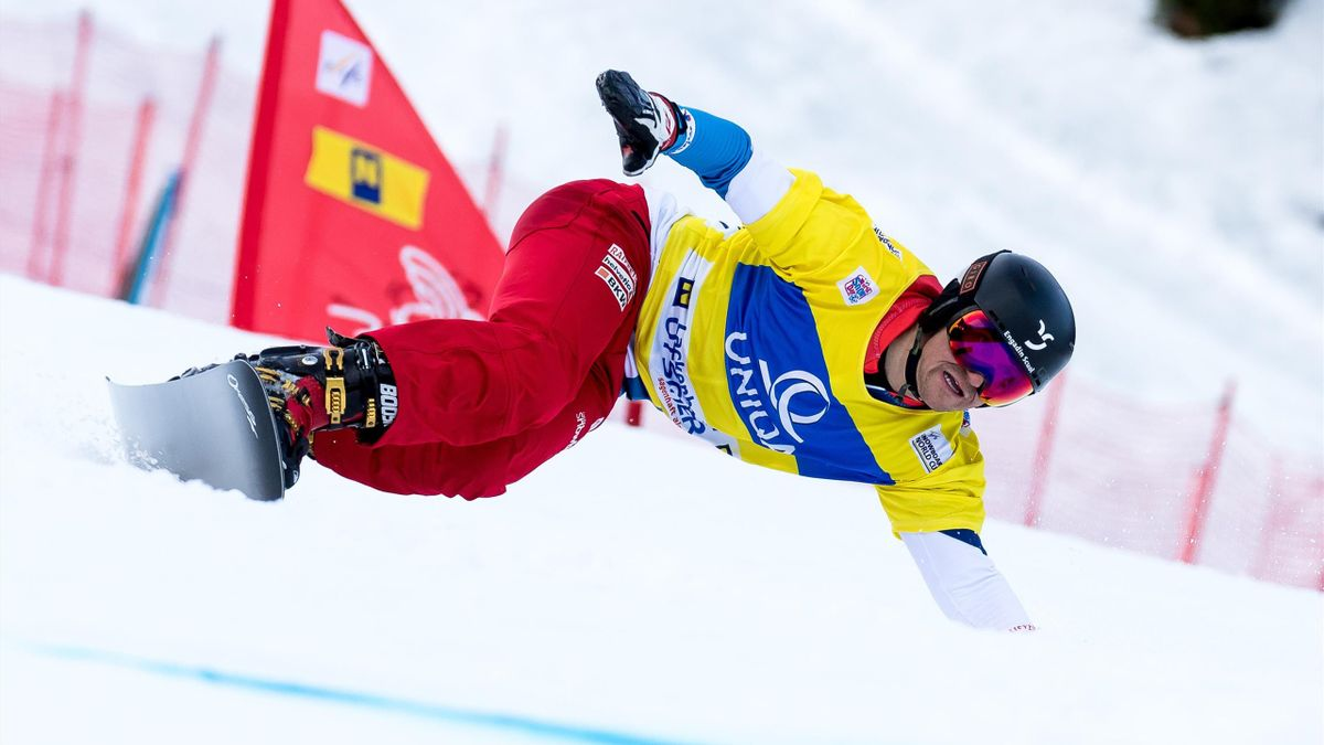 Winner, Nevin Galmarini of Switzerland, competes in the men's Snowboard giant slalom of the FIS Snowboard World Cup in Lackenhof, Austria, on January 5, 2018.