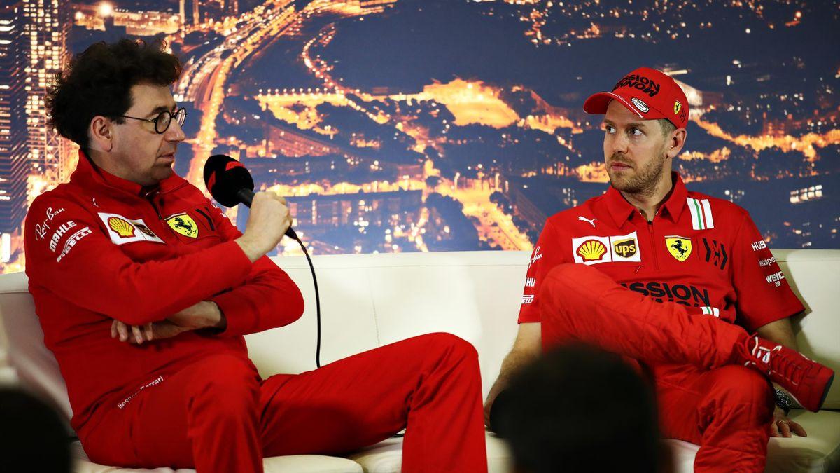 Sebastian Vettel (rechts) und Ferrari-Teamchef Mattia Binotto