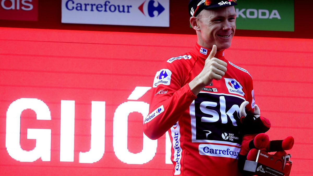 Sky's British cyclist Christopher Froome celebrates retaining the red jersey on the podium