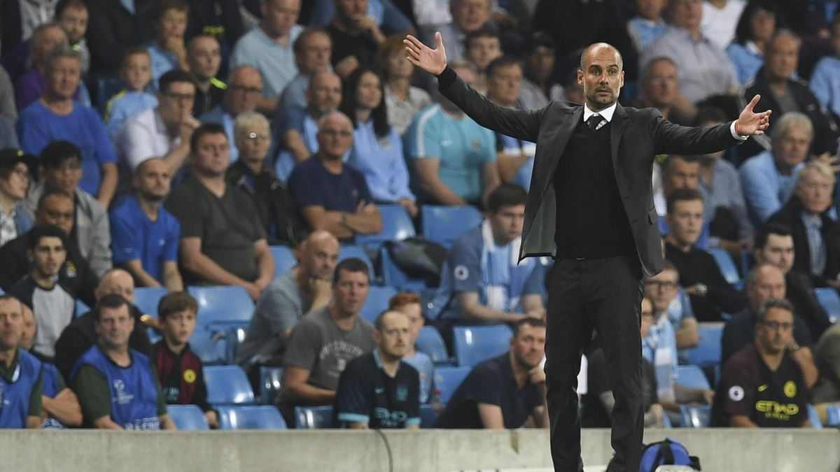 Manchester City's Spanish manager Pep Guardiola gestures on the touchline during the UEFA Champions League group C football match between Manchester City and Borussia Monchengladbach at the Etihad stadium in Manchester, northwest England, on September 14,