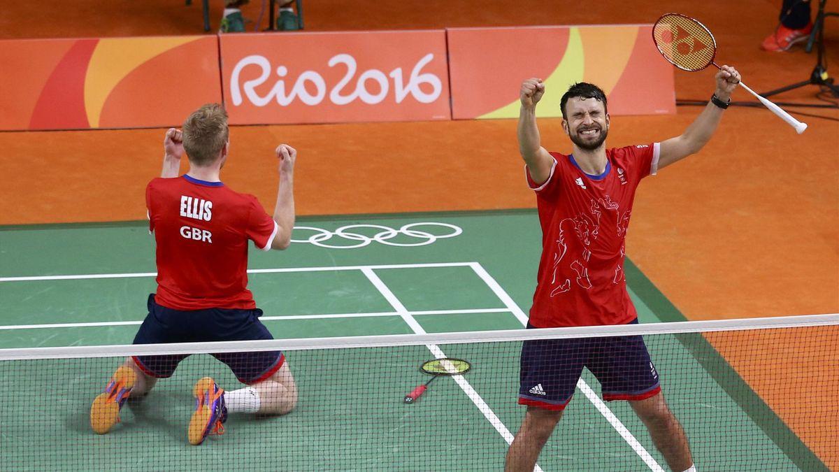 Chris Langridge (GBR) of Britain and Marcus Ellis (GBR) of Britain celebrate after winning their match against Kim Ki-Jung (KOR) of South Korea and Kim Sa-Rang (KOR) of South Korea.