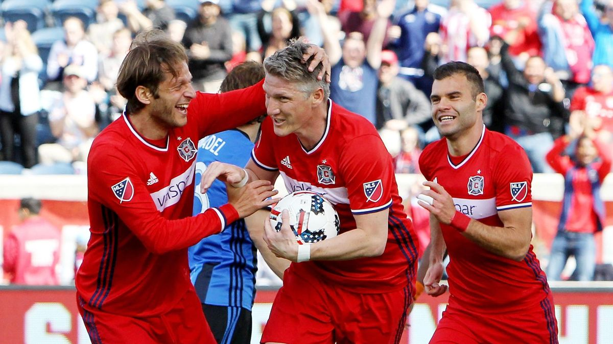 BRIDGEVIEW, IL - APRIL 1: Bastian Schweinsteiger #31 of Chicago Fire celebrates with Joao Meira #66 and Nemanja Nikolic #23 after scoring a goal in the first half against the Montreal Impact during an MLS match at Toyota Park on April 1, 2017 in Bridgevie