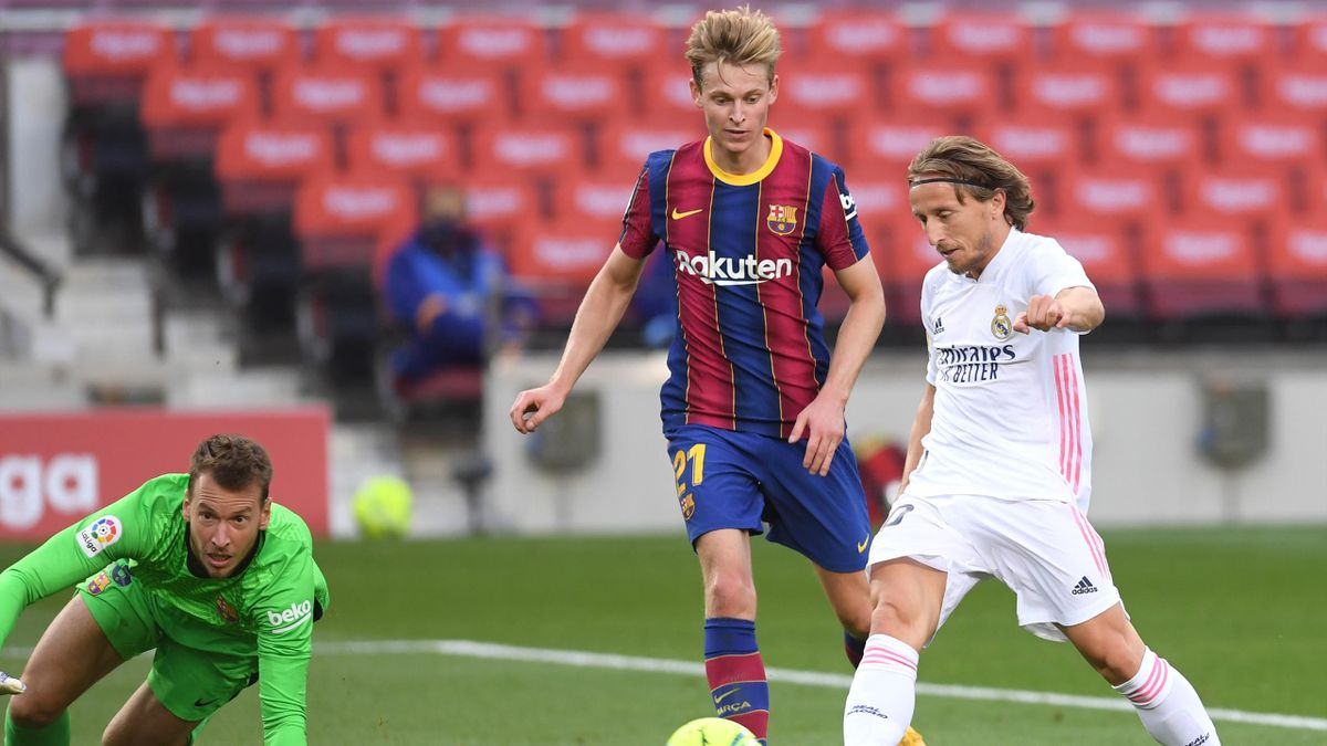 Luka Modric of Real Madrid scores his team's third goal during the La Liga Santander match between FC Barcelona and Real Madrid at Camp Nou on October 24, 2020 in Barcelona, Spain.