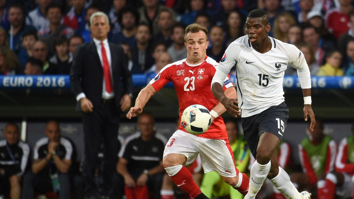 Switzerland's midfielder Xherdan Shaqiri vies for the ball against France's midfielder Paul Pogba during the Euro 2016 group A football match between Switzerland and France at the Pierre-Mauroy stadium in Lille on June 19, 2016