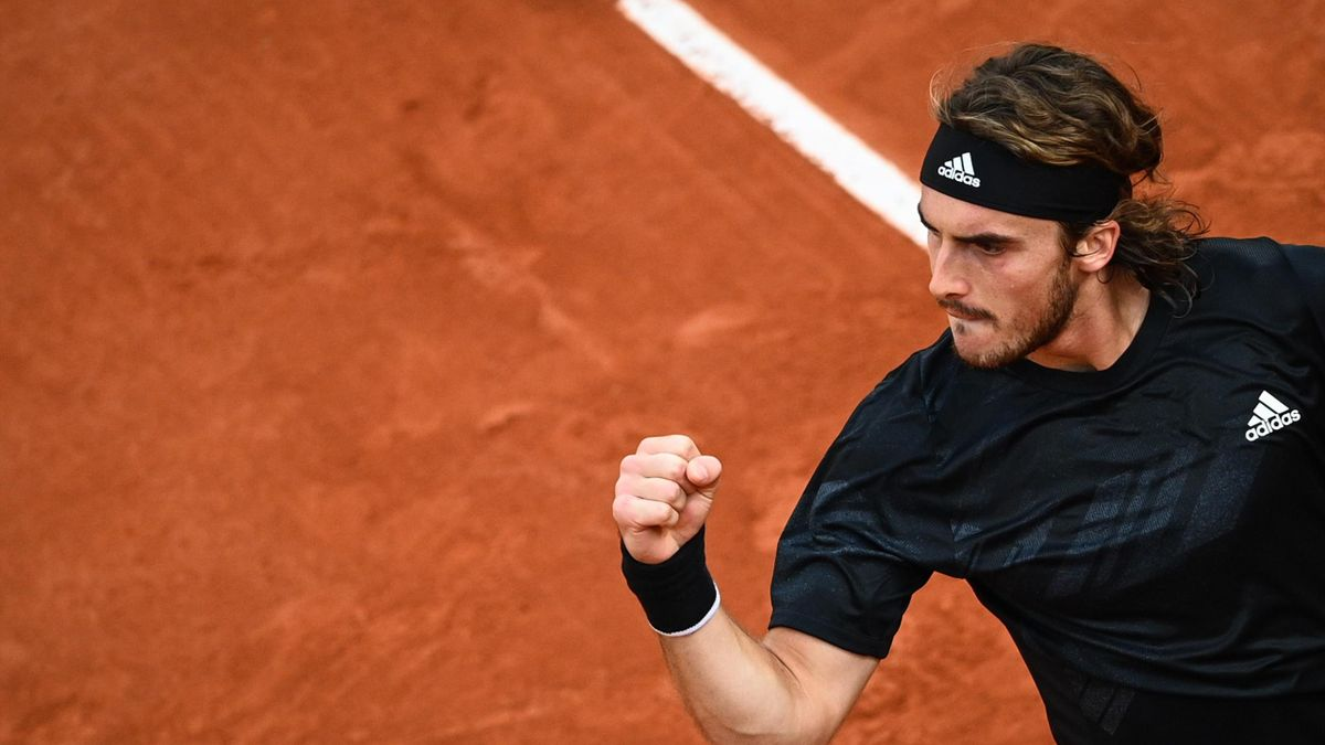 Greece's Stefanos Tsitsipas reacts after winning a point against Russia's Andrey Rublev during their men's singles quarter-final tennis match on Day 11 of The Roland Garros