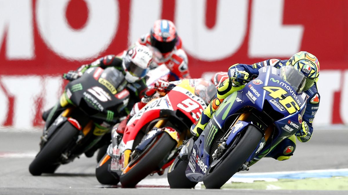 Valentino Rossi (R) wins the Assen Motorcycling Grand Prix at the TT circuit in Assen on June 25, 2017