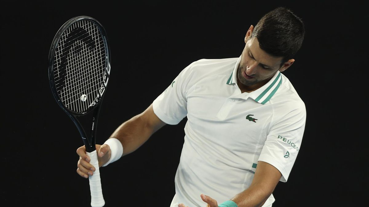 Serbia's Novak Djokovic reacts while playing against Canada's Milos Raonic