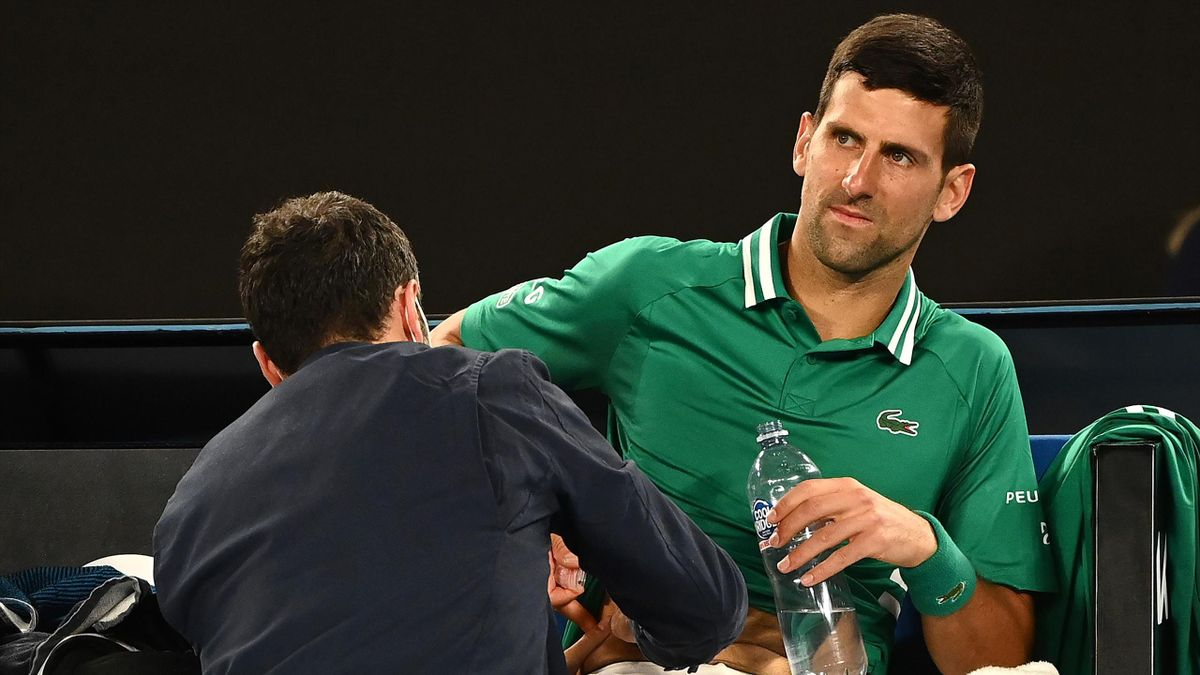 Novak Djokovic of Serbia received medical treatment in his Men's Singles third round match against Taylor Fritz of the United Statesduring day five of the 2021 Australian Open at Melbourne Park on February 12, 2021 in Melbourne, Australia