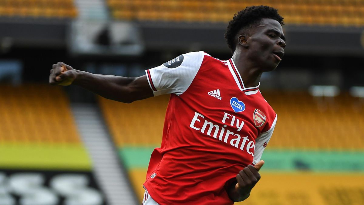 Bukayo Saka of Arsenal celebrates after scoring a goal to make it 0-1 during the Premier League match between Wolverhampton Wanderers and Arsenal FC at Molineux on July 4, 2020