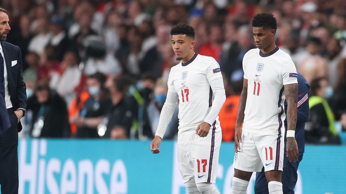 Jadon Sancho and Marcus Rashford of England wait to be substituted on during the UEFA Euro 2020 Championship Final between Italy and England