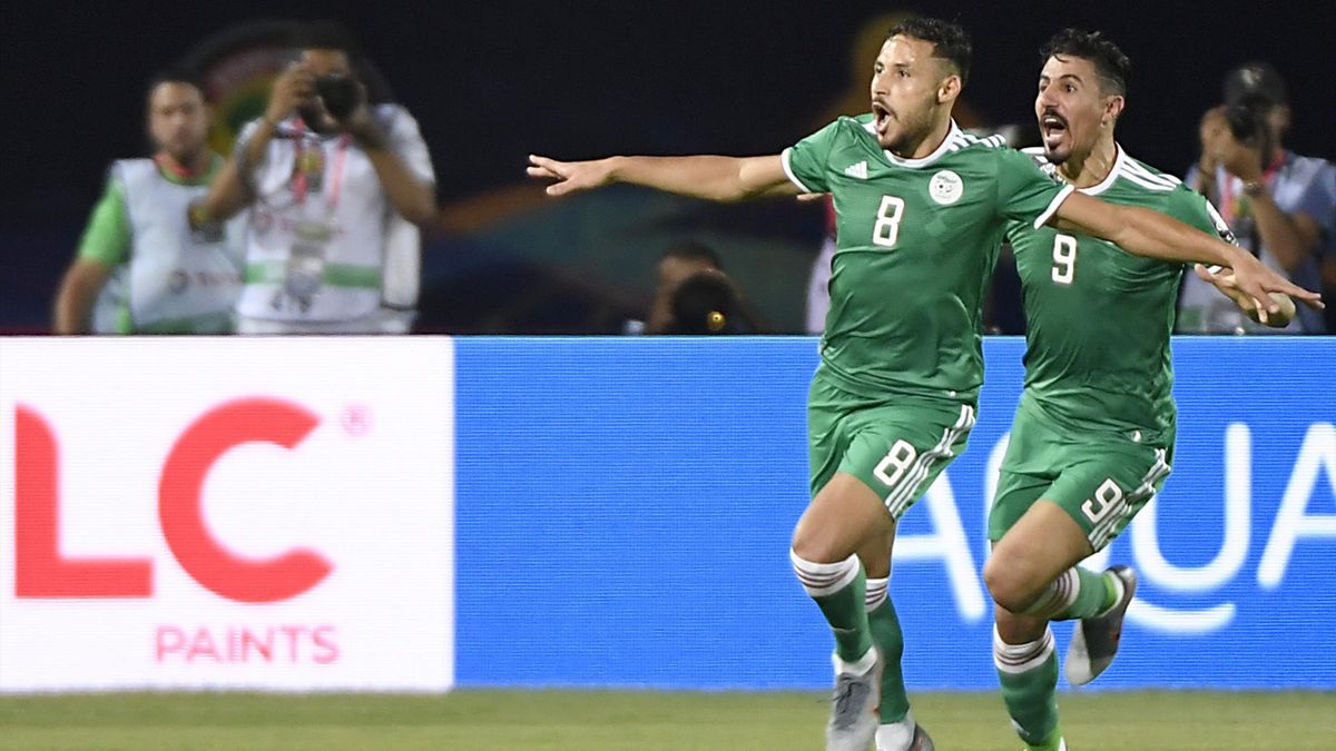 Algeria's forward Youcef Belaili (L) celebrates after scoring a goal during the 2019 Africa Cup of Nations (CAN) football match between Senegal and Algeria at the June 30 Stadium in Cairo on June 27, 2019