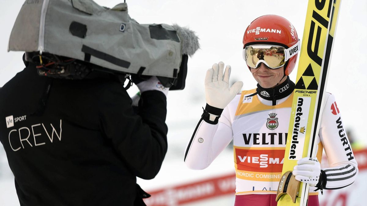 Eric Frenzel of Germany waves into a tv-camera