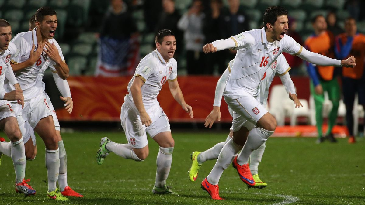 Marko Grujic (16) leads Serbia's celebrations after beating USA on penalties at the U20 World Cup