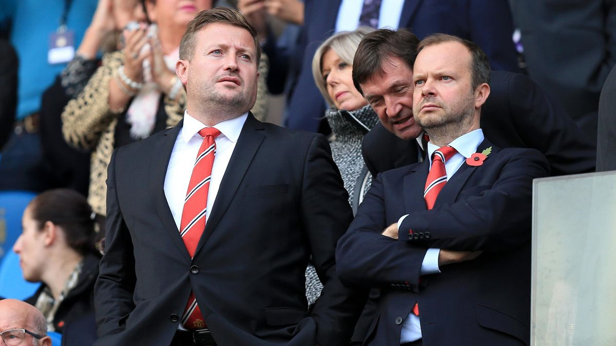 Manchester United group managing director Richard Arnold (left) and executive vice-chairman Ed Woodward with John Alexander,Club Secretary (back)