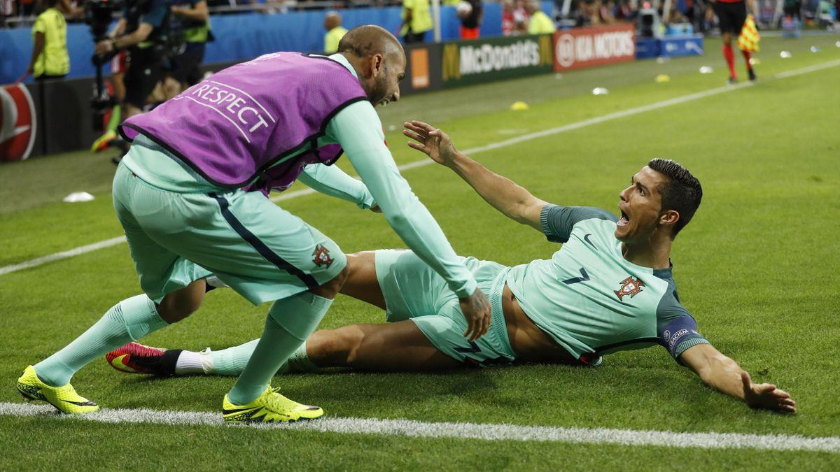 Portugal's Cristiano Ronaldo celebrates with Ricardo Quaresma after scoring their first goal