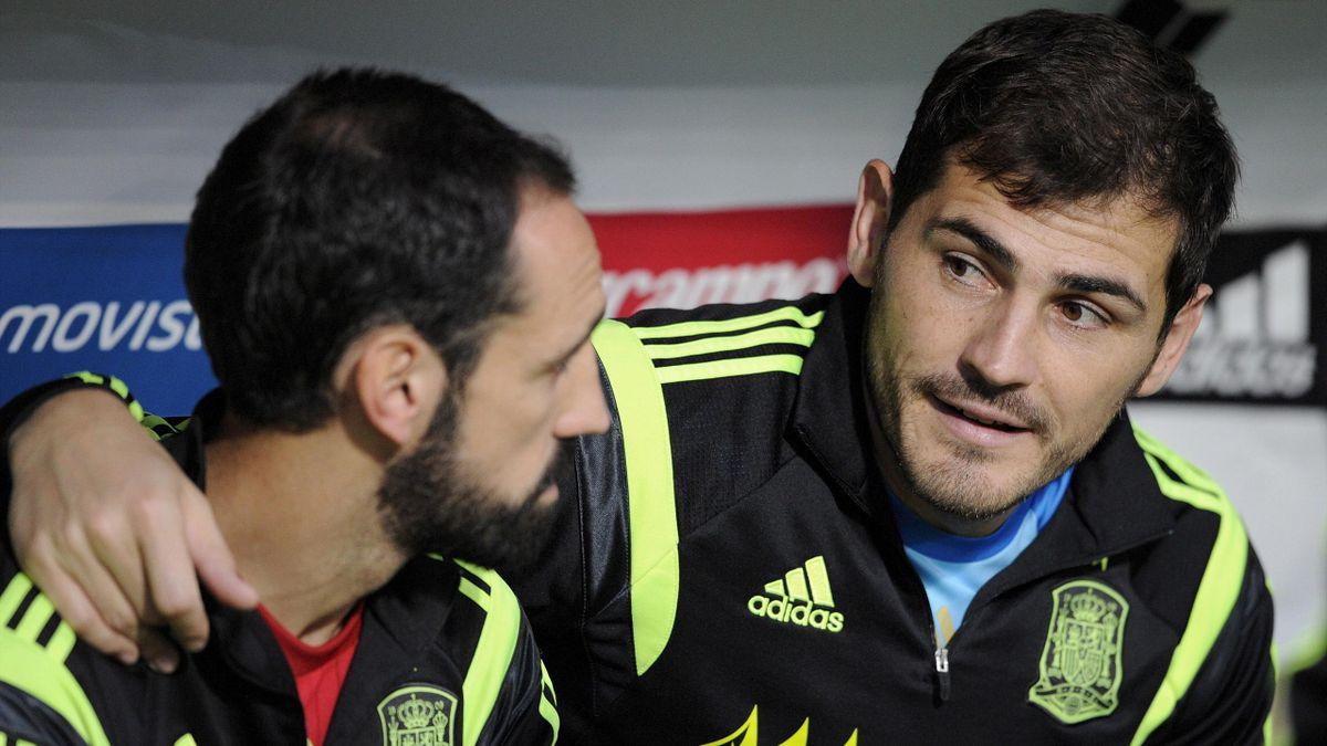 Spain's goalkeeper Iker Casillas (R) speaks with teammate Juanfran before their international friendly soccer match against Costa Rica at the Reino de Leon stadium in Leon, northern Spain, June 11, 2015