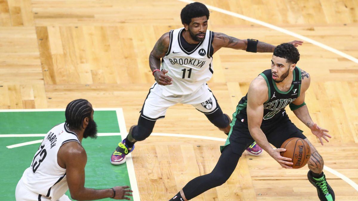 BOSTON, MA - MAY 28: Jayson Tatum #0 of the Boston Celtics is guarded by Kyrie Irving #11 and James Harden #13 of the Brooklyn Nets during Game Three of the Eastern Conference first round series at TD Garden on May 28, 2021 in Boston, Massachusetts. NOTE