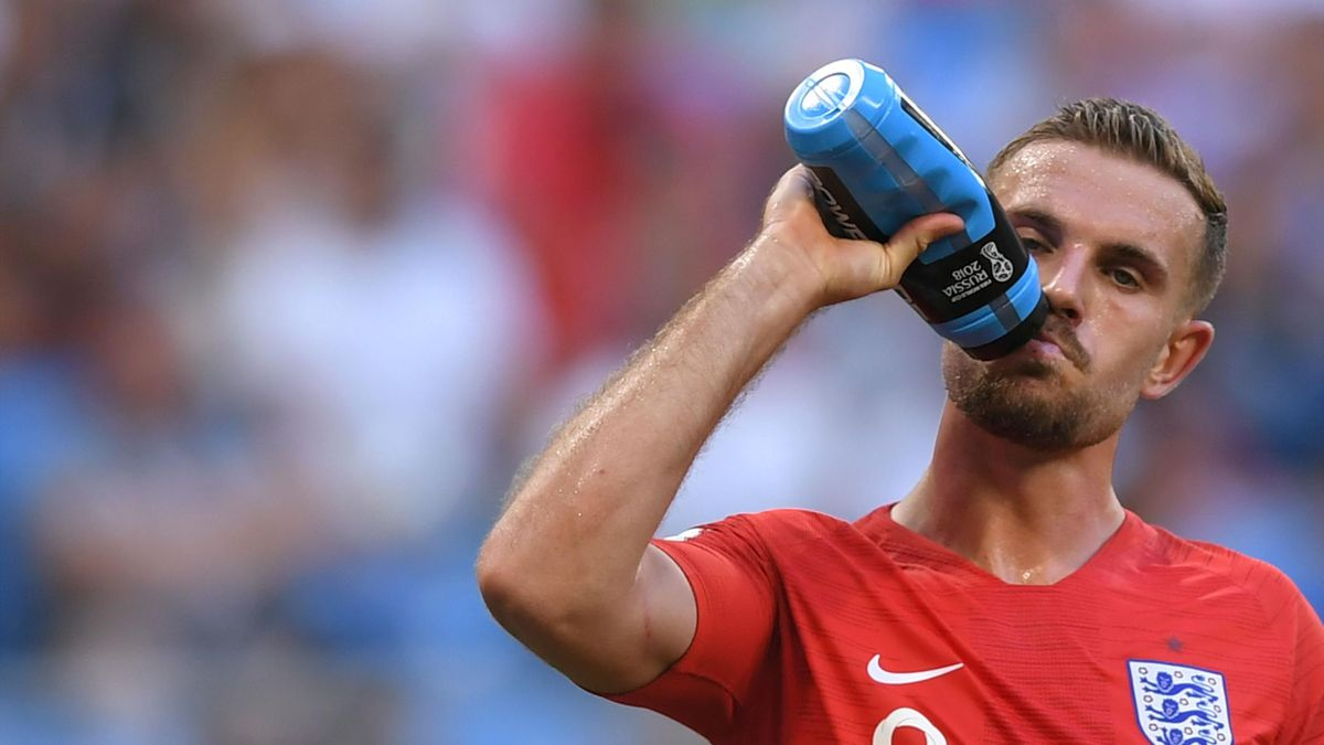 England's midfielder Jordan Henderson drinks water during the Russia 2018 World Cup quarter-final football match between Sweden and England at the Samara Arena in Samara on July 7, 2018.