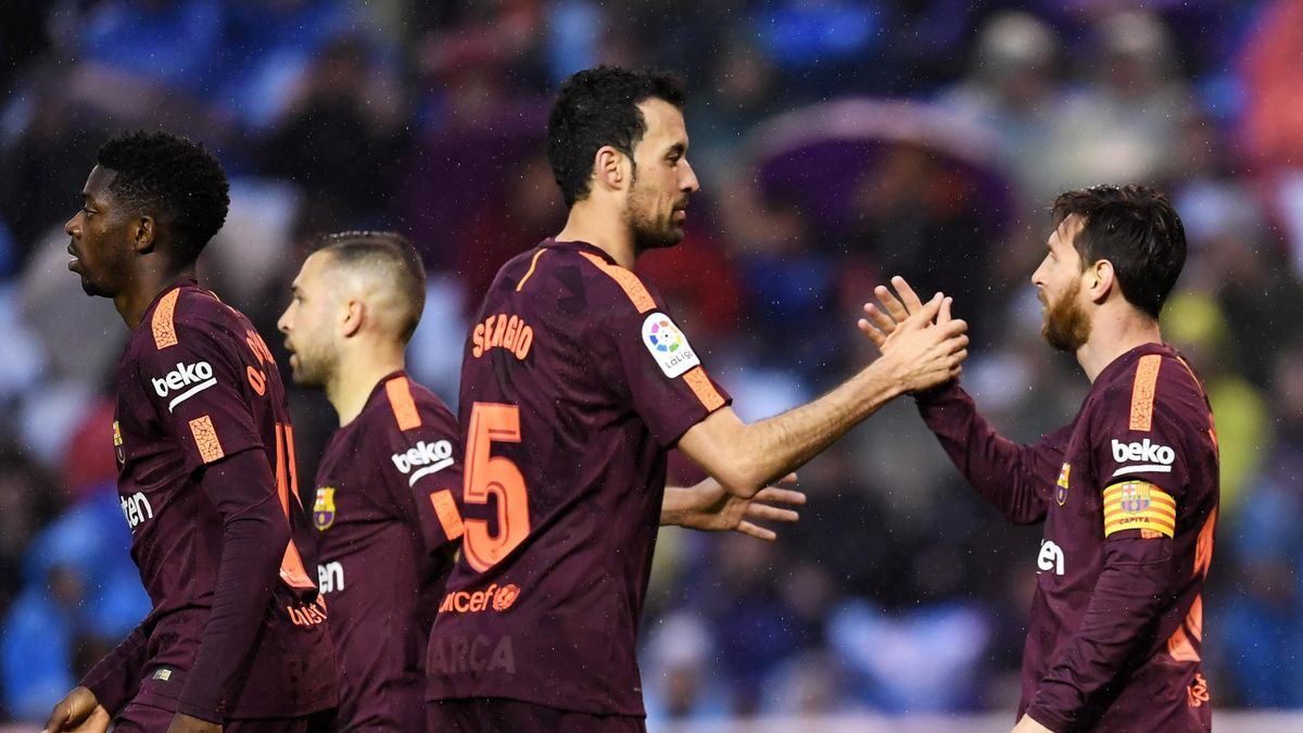 Lionel Messi of Barcelona celebrates as he scores his sides second goal with Sergio Busquets of Barcelona during the La Liga match between Deportivo La Coruna and Barcelona at Estadio Riazor on April 29, 2018 in La Coruna, Spain.
