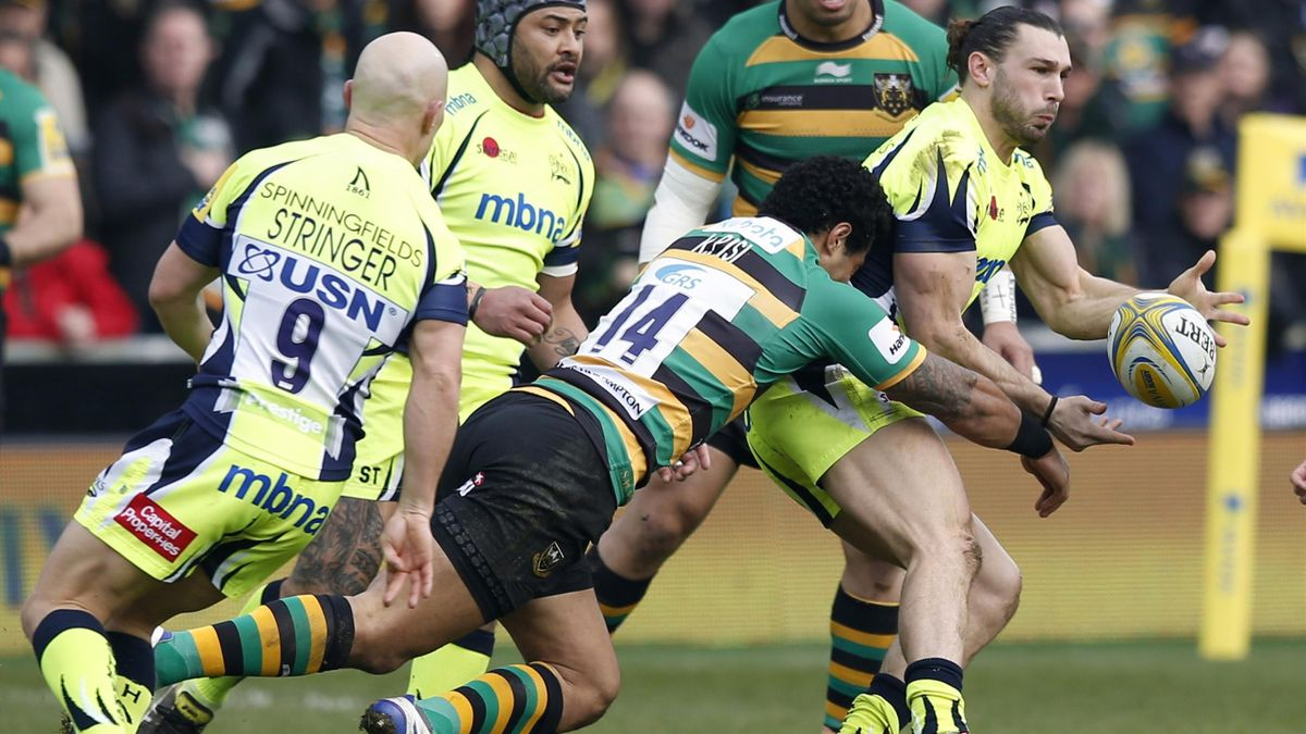 Sale's Tom Arscott is tackled by Northampton's Ken Pisi.