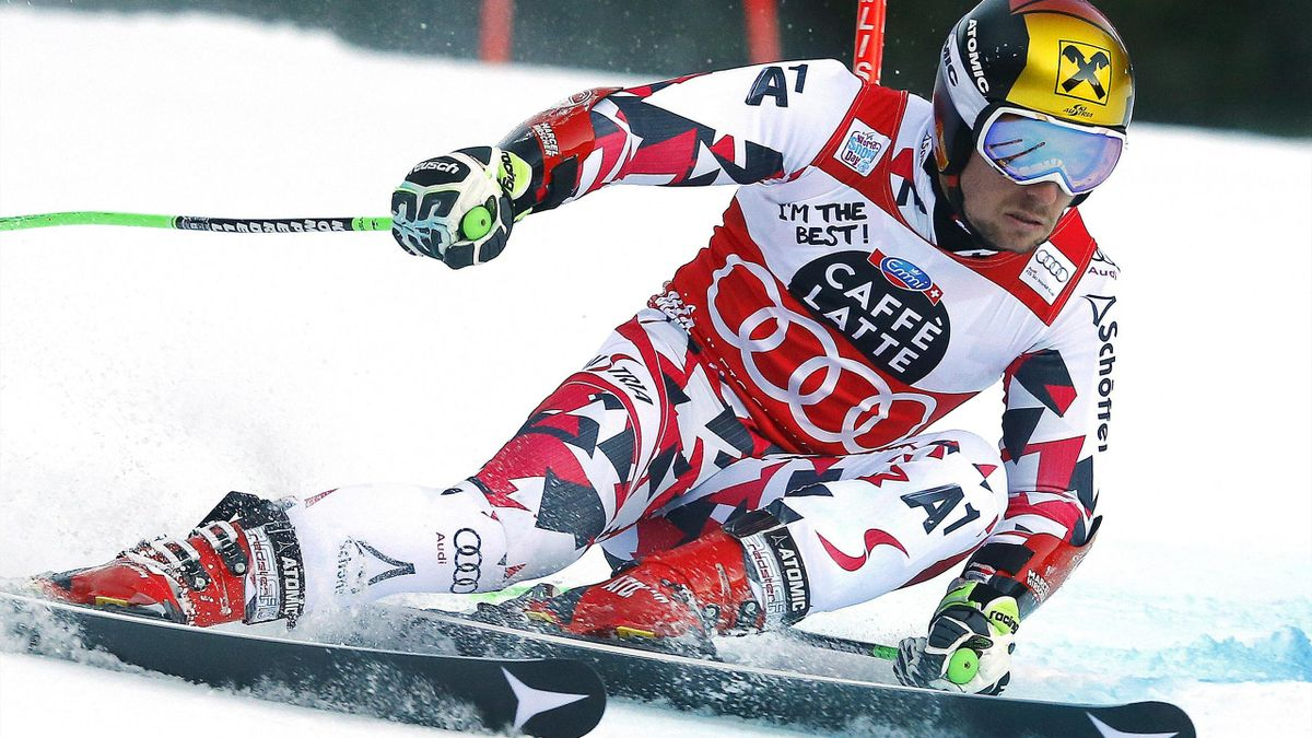 Marcel Hirscher of Austria clears a gate during the first run in the men's giant slalom at the Alpine Skiing World Cup in Alta Badia, northern Italy, December 20, 2015.