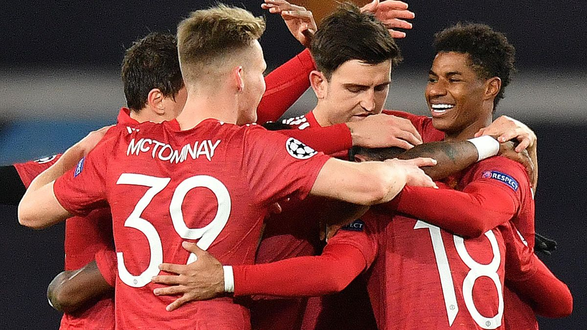 Marcus Rashford (R) celebrates scoring his team's second goal during the UEFA Champions league group H football match between Manchester United and RB Leipzig at Old Trafford stadium in Manchester