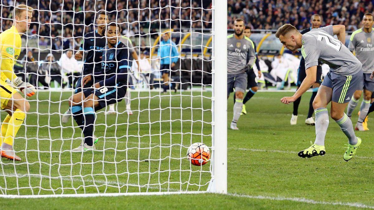 Real Madrid's Denis Cheryshev scores their fourth goal against Manchester City