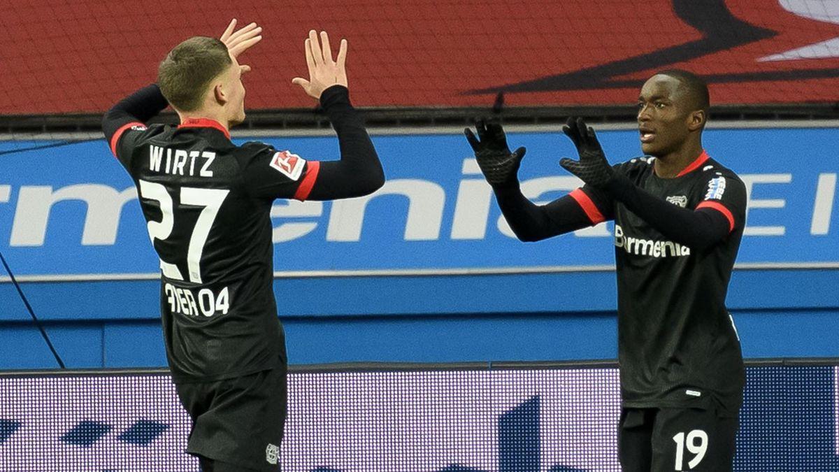 Bayer Leverkusen's Moussa Diaby (R) celebrates scoring against Borussia Dortmund