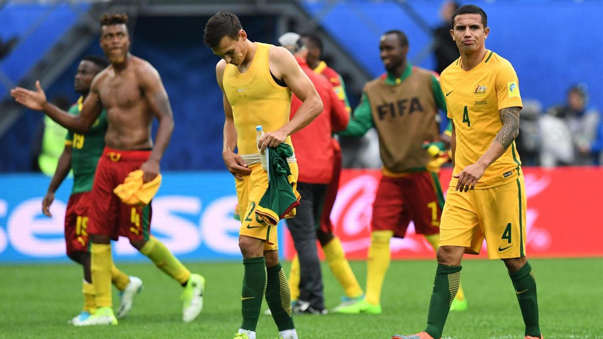 Australia's defender Trent Sainsbury (C) leaves the pitch at the end of the 2017 Confederations Cup group B football match between Cameroon and Australia at the Saint Petersburg Stadium on June 22, 2017