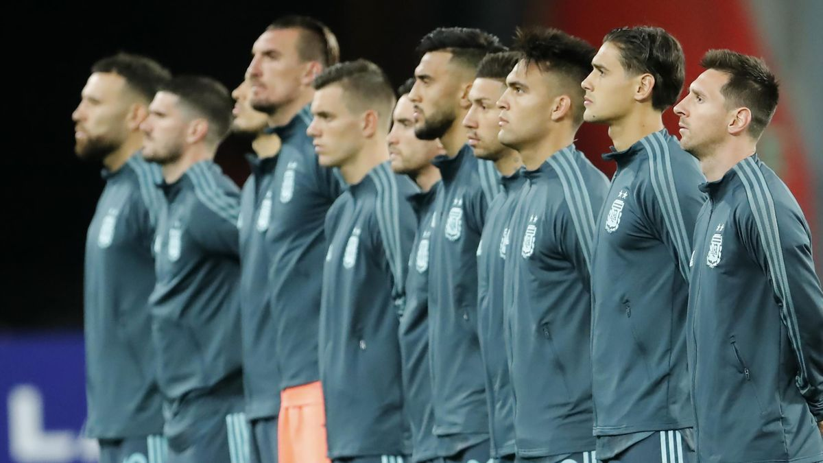 Lionel Messi of Argentina (R) and teammates line up prior to a match between Peru and Argentina as part of South American Qualifiers for World Cup FIFA Qatar 2022