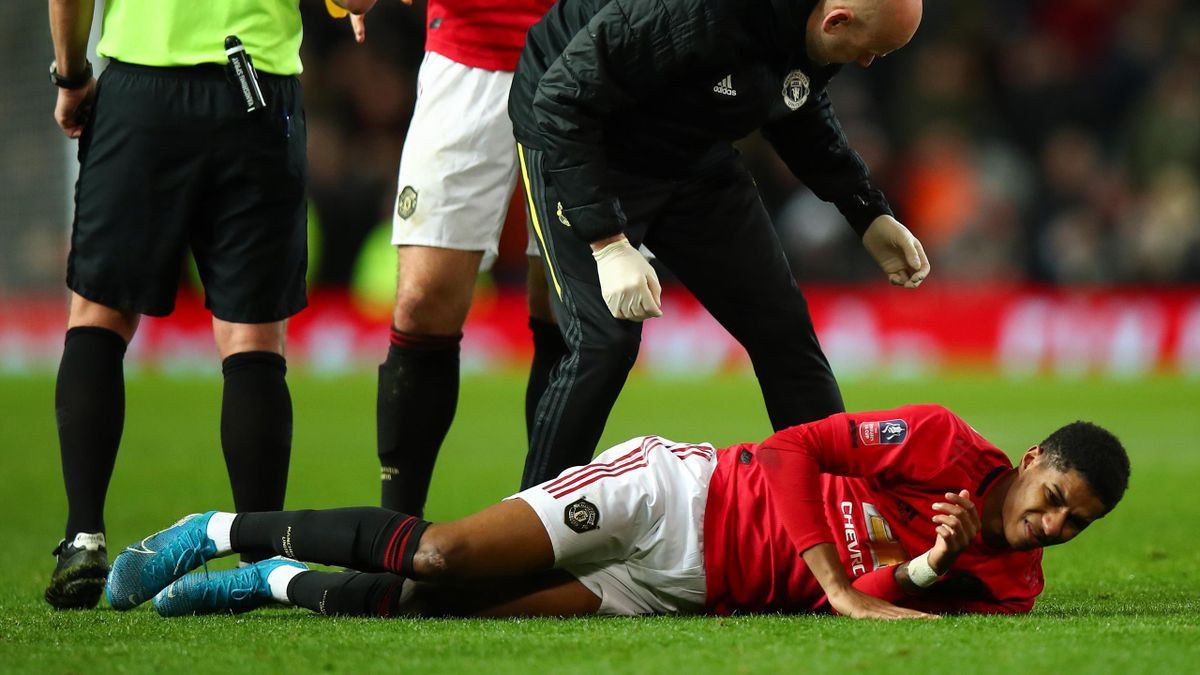 Marcus Rashford of Manchester United goes down injured during the FA Cup Third Round Replay match between Manchester United and Wolverhampton Wanderers at Old Trafford on January 15, 2020 in Manchester, England.