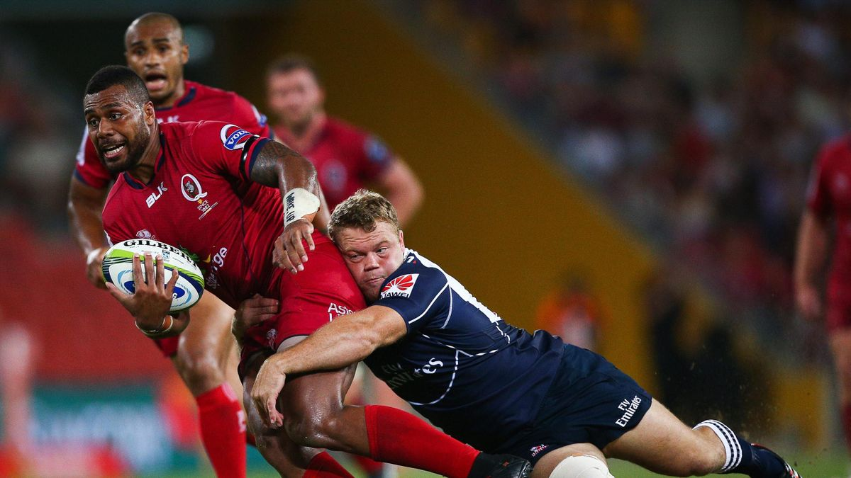 Reds player Samu Kerevi (L) is tackled by Lions player Armand van der Merwe during the Super 15 rugby match between Queensland Reds and South Africa's Lions at Suncorp Stadium in Brisbane on March 27, 2015 (AFP)