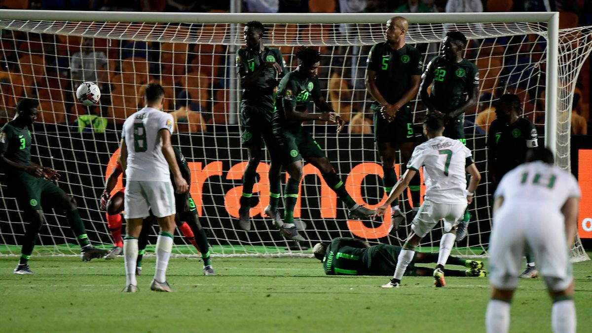 Algeria's forward Riyad Mahrez (R) scores from a free-kick during the 2019 Africa Cup of Nations (CAN) Semi-final football match between Algeria and Nigeria at the Cairo International stadium in Cairo on July 14, 2019. (Photo by JAVIER SORIANO / AFP) (Pho