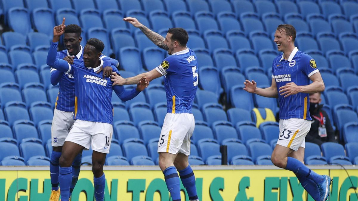 Brighton's English striker Danny Welbeck (2L) celebrates scoring his team's second goal