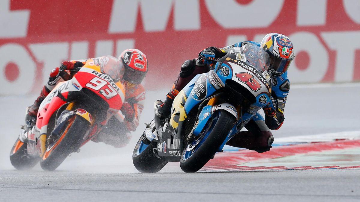 Australian GP rider Jack Miller (R) of the Honda team and Spanish GP rider Marc Marquez