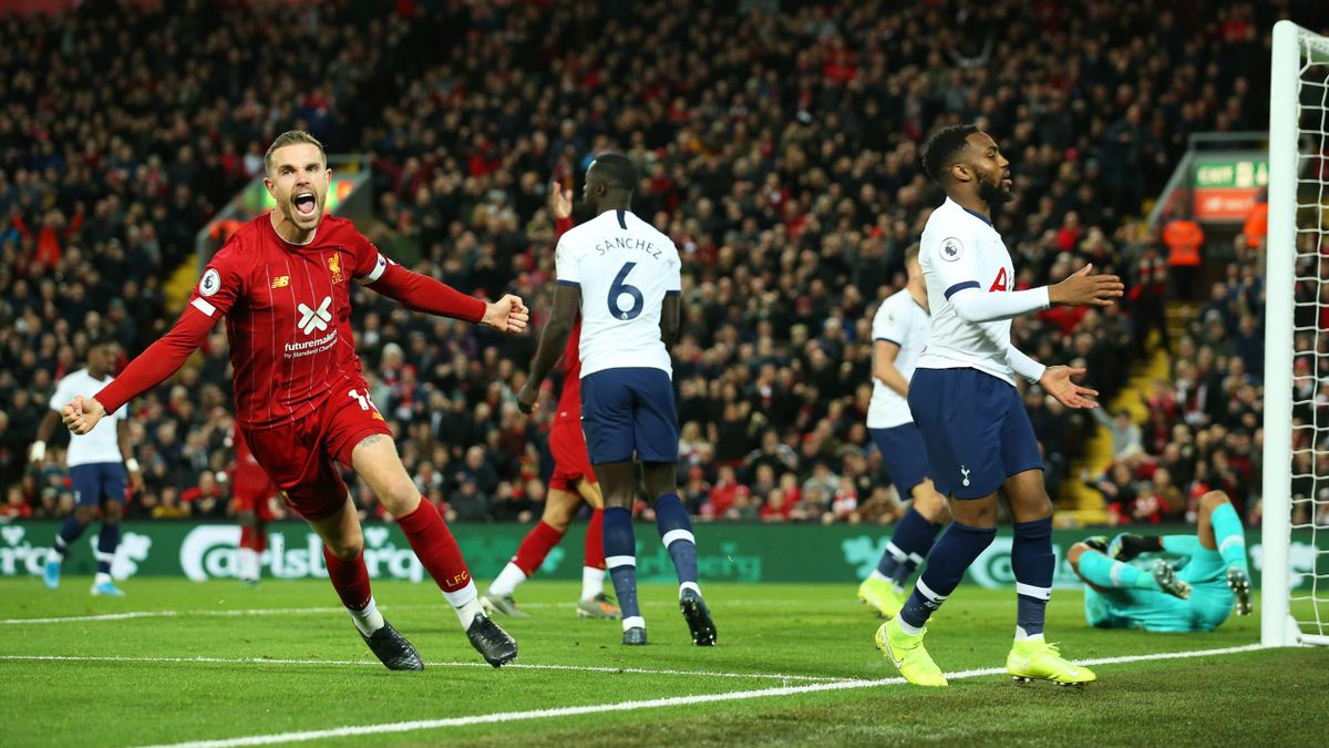 ordan Henderson of Liverpool (L) celebrates after scoring his team's first goal during the Premier League match between Liverpool FC and Tottenham Hotspur at Anfield on October 27, 2019 in Liverpool, United Kingdom.