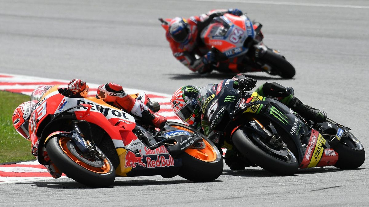 Repsol Honda Team Spanish rider Marc Marquez, Monster Yamaha Tech 3 team French rider Johann Zarco and Ducati Team Italian rider Andrea Dovizioso ride during the Malaysia MotoGP at the Sepang International Circuit in Sepang on November 4, 2018