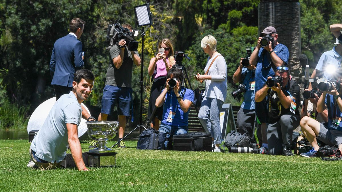 Novak Djokovic of Serbia poses in front of media photographers with the Norman Brookes Challenge Cup after winning the 2019 Australian Open at Picnic Point, Royal Botanical Gardens.