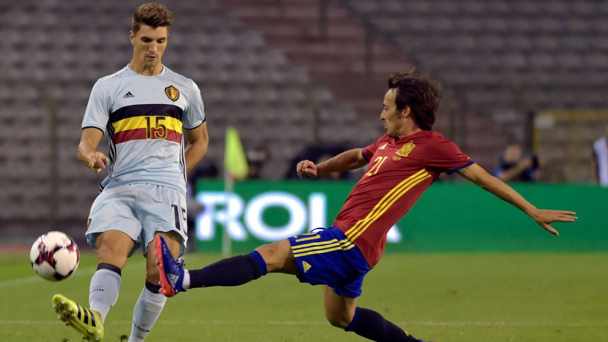 Belgium's Thomas Meunier (L) and Spain's David Silva in action.