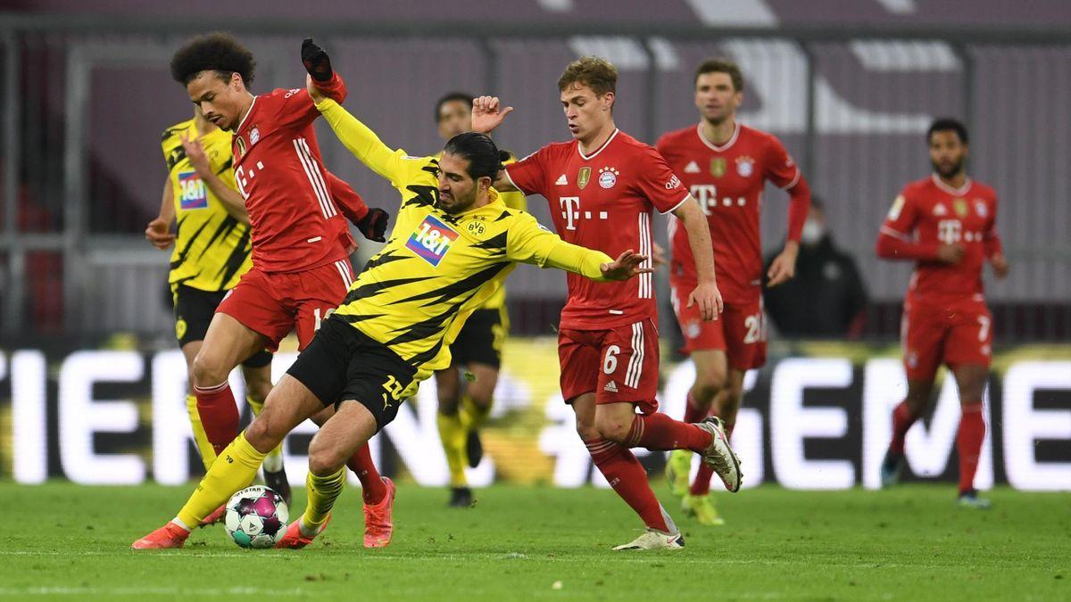 Leroy Sané schiebt Emre Can beiseite - kurz darauf fällt das 3:2 für den FC Bayern im Top-Spiel gegen Borussia Dortmund