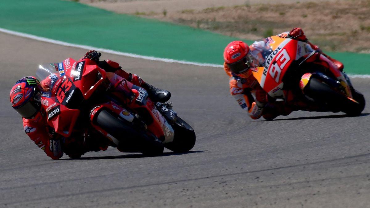 Ducati Italian rider Francesco Bagnaia rides his bike ahead of 93 Honda Spanish rider Marc Marquez (R) during the Moto Grand Prix of Aragon at the Motorland circuit in Alcaniz on September 12, 2021
