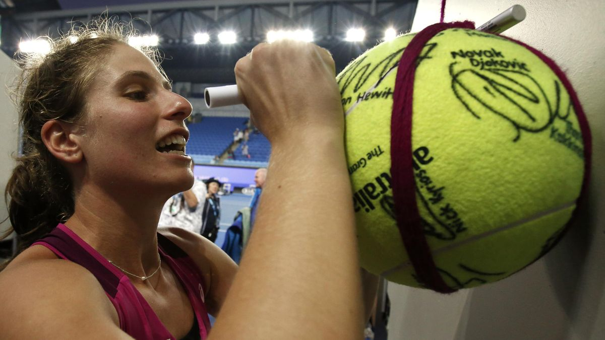 Britain's Johanna Konta signs autographs after winning her fourth round match against Russia's Ekaterina Makarova